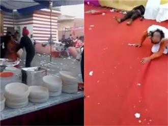 Miếng ăn là miếng tồi tàn, mất ăn một miếng quan khách liền lao vào đánh nhau làm náo loạn cả đám cưới