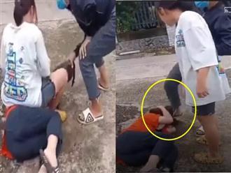 Xôn xao clip bé gái 13 tuổi ở Đồng Nai bị 2 cô gái hành hung, đạp túi bụi vào đầu, nguyên nhân chỉ vì 'tiếng gọi'
