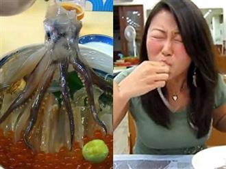 """Ăn bạch tuộc sống, người phụ nữ bỗng dưng """"mang bầu"""" cả đàn bạch tuộc con trong miệng"""