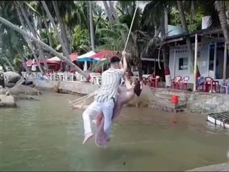 Lãng mạn đu dây tạo kiểu chụp ảnh cưới, cô dâu chú rể lọt thẳng xuống sông khiến dân tình cười rớt hàm