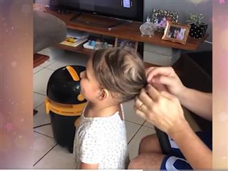 Khó tin cảnh ông bố dùng máy hút bụi cột tóc cho con gái, 'ông bố sáng chế' của năm là đây chứ đâu!