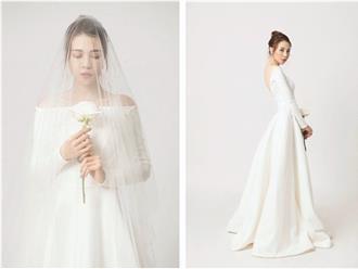 Lộ ảnh cô dâu của Cường Đô la diện váy cưới lộng lẫy, tay cầm hoa, đầu đội khăn voan xinh đẹp