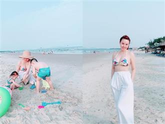 Mẹ 2 con Vy Oanh diện bikini khoe vòng 1 căng tròn, quyến rũ trước biển