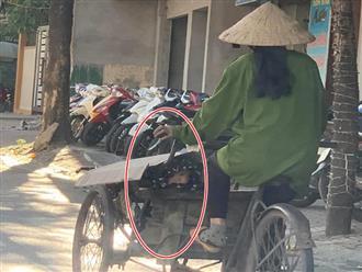 Người phụ nữ đạp xích lô chở hàng giữa trời nắng, gương mặt lấp ló trong xe khiến tất cả lặng người