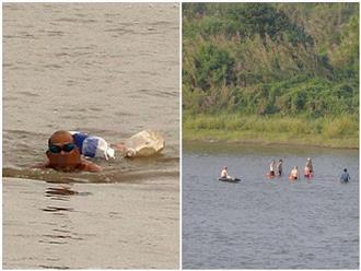 Bất chấp lệnh giãn cách xã hội, nhiều 'kình ngư' Thủ đô vẫn tụ tập ra bãi tắm 'lộ thiên' dưới chân cầu Long Biên để giải nhiệt mùa hè