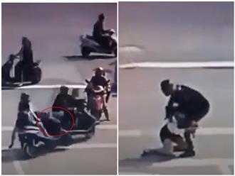 Nam thanh niên 'hôn' đầu xe cô gái trẻ còn cộc cằn giở thói côn đồ, 1 phút sau nhận ngay bài học xương máu