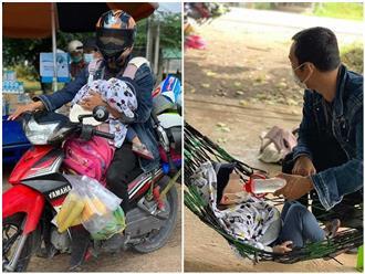 Người bố địu con nhỏ trước ngực, một tay chạy xe máy từ Đồng Nai về Hà Tĩnh tránh dịch: 'Bé nhớ hơi mẹ nên khóc mãi'