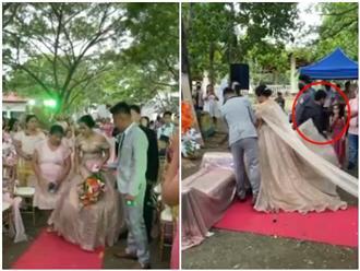 Người đàn ông 'núp lùm' trốn trong váy cô dâu khiến quan khách 'bất ngờ, ngơ ngác, ngỡ ngàng đến bật ngửa'