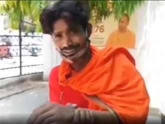 Không đeo khẩu trang, người đàn ông Ấn Độ bị cảnh sát đóng đinh vào tay và chân