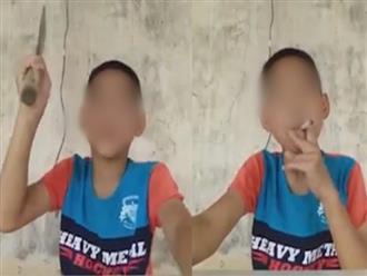 """Bé trai 16 tuổi vừa hút thuốc phì phèo vừa quay clip xưng """"giang hồ"""" cầm dao đòi chém người nào muốn tìm mình khiến cộng đồng mạng phẫn nộ"""