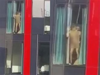 Văn phòng đối diện khách sạn, hàng chục người 'đỏ mặt' chứng kiến cảnh cặp đôi kéo rèm 'mây mưa', lời kể của nhân chứng càng gây bức xúc hơn