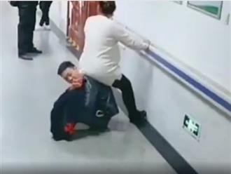Clip chồng ngồi xổm làm ghế cho vợ bầu trong bệnh viện: Thương vợ hay làm màu?
