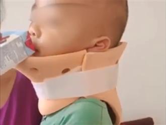CLIP: Bé trai bị bố ném từ tầng 3 xuống đang nẹp cổ, khóc òa khi người lạ đến thăm