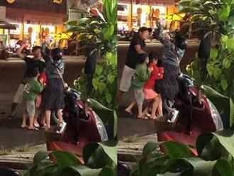 Clip chồng dùng nón bảo hiểm đánh vợ bầu trước mặt con nhỏ khiến người đi đường bức xúc