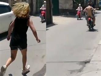 Clip cô gái vừa đuổi theo chàng trai khỏa thân trên đường vừa gào 'trả tiền đây' gây bức xúc