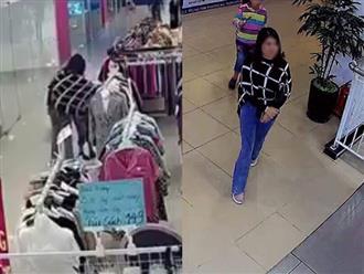 Clip gây bức xúc: Người phụ nữ để con nôn vào quần áo trong tiệm rồi nghênh ngang bỏ đi