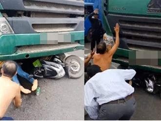 Clip người dân la hét, hô hoán để cứu cô gái bị cuốn vào gầm xe tải nóng nhất MXH ngày 8/3
