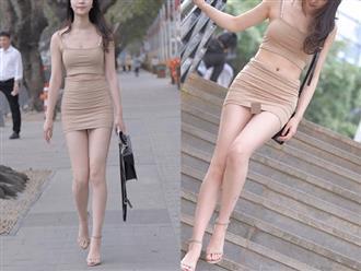 Cô nàng có dáng chuẩn như siêu mẫu thả dáng trên đường nhưng dân tình chỉ dán mắt vào bộ quần áo như 'tàng hình'