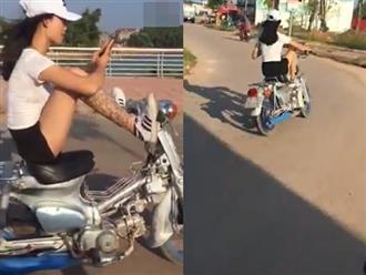 Clip 'hot girl xăm trổ' dùng hai chân lái xe trên phố gây xôn xao