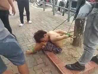 Tạm giữ 3 người hành hung, trói cậu bé đánh giày vào gốc cây