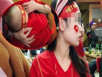 Hình ảnh nhận triệu like sau trận Philippines - Việt Nam: Mẹ vừa cổ vũ bóng đá vừa cho con bú