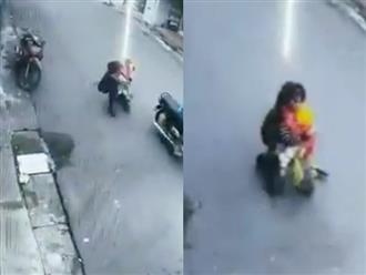 Clip người mẹ bế con nhỏ trên tay vẫn kiên quyết đuổi theo giằng co với tên cướp gây tranh cãi