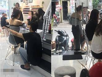 Thanh niên ngồi hai tiếng chờ người yêu làm móng, xỏ dép cho bạn gái khi về vì sợ trầy sơn gây tranh cãi