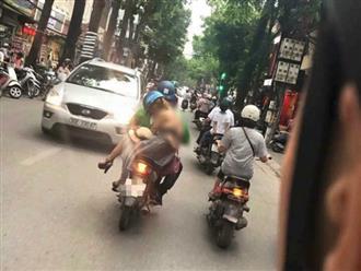 Tranh cãi hình ảnh cô gái 'mặc như không' nghênh ngang giữa phố mặc người đi đường dòm ngó