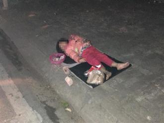 """Xúc động hình ảnh bé gái """"ăn xin"""" nằm ngủ trên vỉa hè giữa đêm lạnh"""