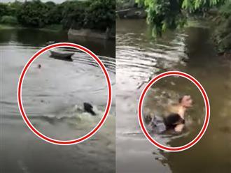 Thấy người đàn ông bị đuối nước chú chó bơi như bay kéo nạn nhân vào bờ, đến sen cũng 'câm nín'