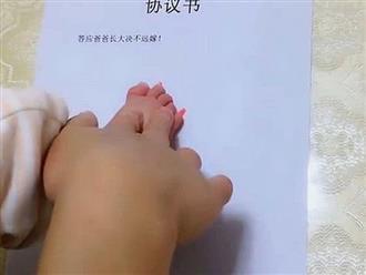 Con gái mới sinh bị bố 'lừa' điểm chỉ vào bản thỏa thuận, mẹ xem xong vừa buồn cười vừa cảm động