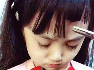 Bị mẹ cắt tóc lởm chởm, bé gái vừa mở mắt đã khiến thiên hạ ồ lên kinh ngạc