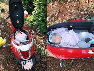 Hình ảnh mẹ đặt con nằm trong cốp xe máy để rảnh tay làm rẫy gây tranh cãi