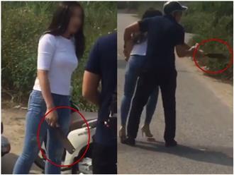 Bắt quả tang chồng sắp cưới đi với gái lạ, cô gái chặn đầu xe vác dao dọa chém