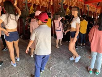 Cô gái trẻ mặc áo hở rốn, quần ngắn cũn cỡn vào chùa đầu năm bị dân mạng 'ném đá' không thương tiếc