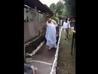 Cô dâu trói tay chân chú rể, kéo lê vào lễ đường gây xôn xao