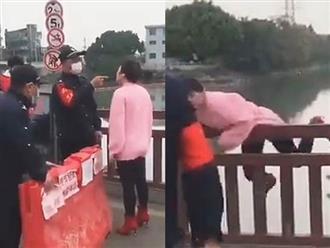 Bị cấm qua cầu vì không mang khẩu trang, người phụ nữ nhảy cầu ăn vạ và cái kết dở khóc dở cười