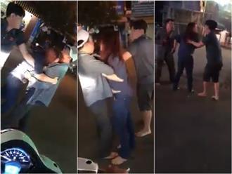 Bị đánh ghen giữa đường, vợ ôm chặt chồng cho nhân tình chạy thoát