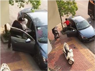 Chồng thuê ô tô chở bồ nhí đi chơi, vợ nhảy lên xe đánh ghen dã man