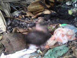 Bàng hoàng phát hiện thi thể bé trai còn nguyên dây rốn trong đống rác đang cháy vào sáng 28 Tết