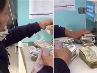 Clip người mẹ khắc khổ đổi từng đồng tiền lẻ để đóng học phí cho con khiến mọi người vỡ òa cảm xúc