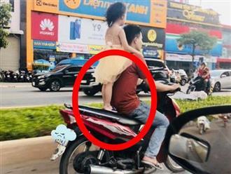 Nam thanh niên để bé gái đứng lên yên xe rồi phóng vù vù, không đội nón bảo hiểm khiến ai nấy bức xúc