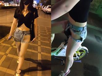 Mặc 'quần què' để lộ vùng kín ngang nhiên diễu phố, thiếu nữ nhận rổ gạch đá từ dân mạng
