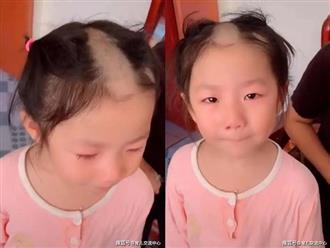 Bé gái cầm tông đơ cắt tóc chơi, mẹ vừa lơ là một chút đã xảy ra 'thảm cảnh kinh hoàng'