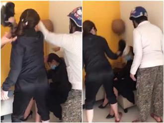 Clip: Vợ cầm nón bảo hiểm đánh ghen dã man tình địch mặc chồng can ngăn
