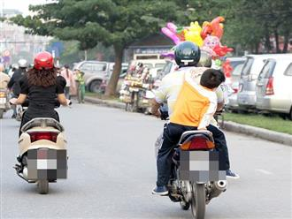 Bố cho con gái ngồi trước xe máy, gặp sự cố bé ngã lao đầu xuống đất cực nguy hiểm: Bố mẹ cảnh giác