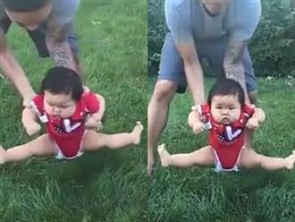 Bố định đặt con xuống bãi cỏ chơi, phản ứng của cô bé khiến ai nấy cười lăn cười bò