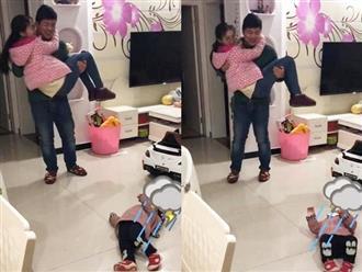 Thấy bố sắp đi công tác bịn rịn ôm mẹ, phản ứng của cô con gái khiến ai nấy phá lên cười