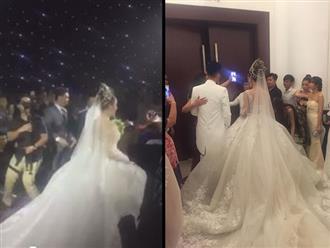 Cận cảnh chiếc váy cưới 'khủng' khiến Lâm Khánh Chi chật vật bước vào lễ đường