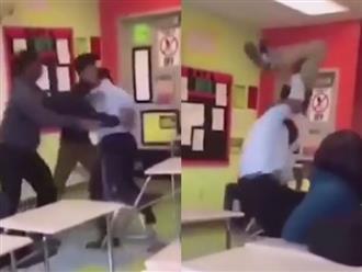 Clip: Thầy giáo bế học sinh lên quăng mạnh xuống mặt bàn